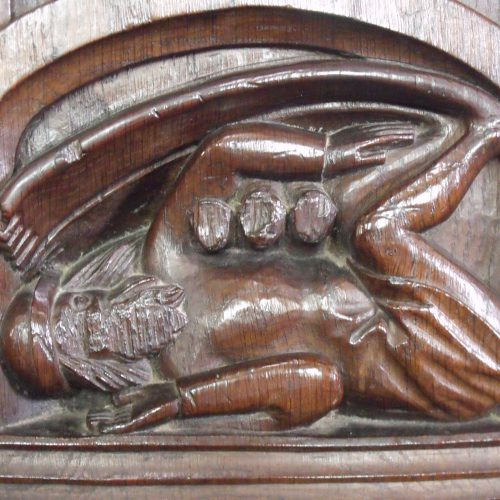 The strange Sciapod at the end of a bench in Dennington church with his large foot shading him from the sun!