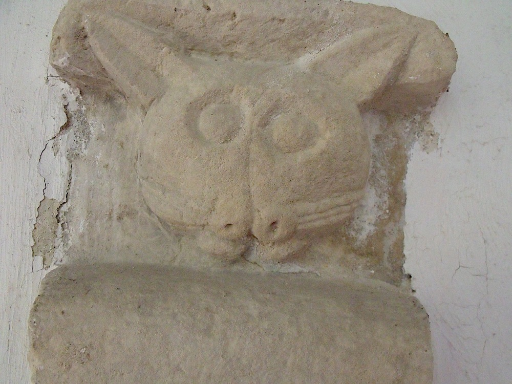 Meow! This cat is over 1,000 years old. Find him in the porch at Badingham church.