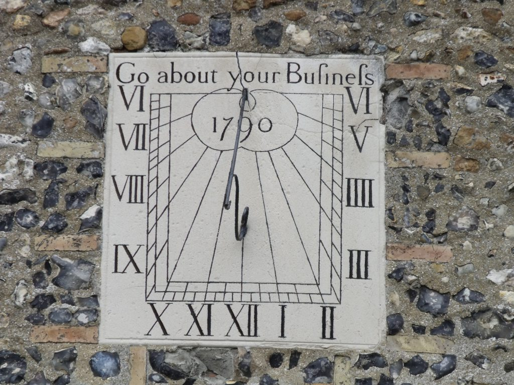 This is a sundial to tell the time of day. You wouldn't spell Business with an f instead of an s would you?