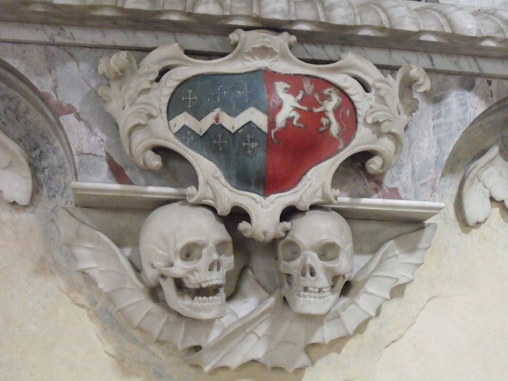 Scarey skulls were put on special monuments to remind people about death. Discover these two at Kedington church.
