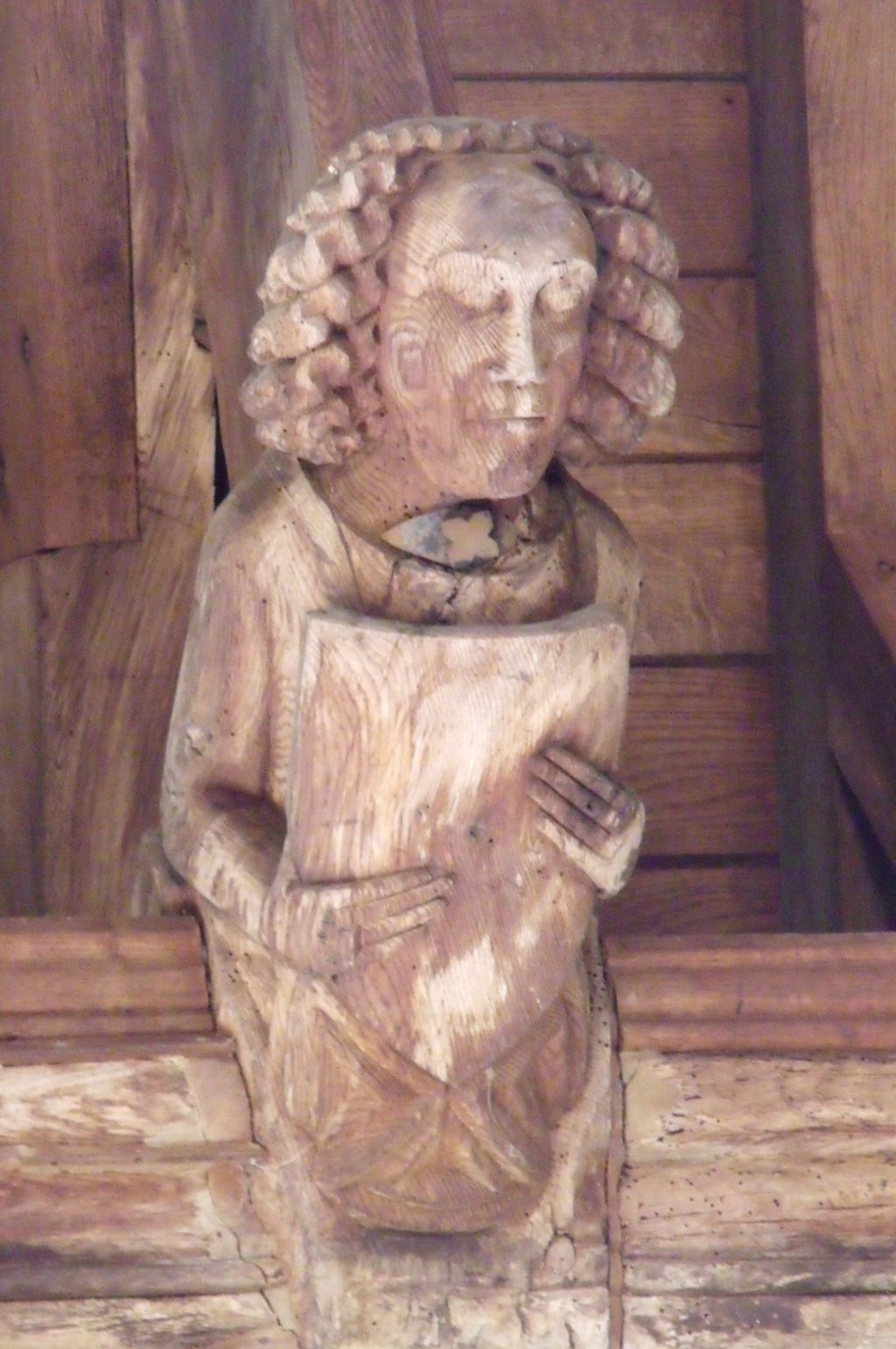 Look! Here's a small angel perched in the roof at Wingfield. He once would have been vividly coloured.