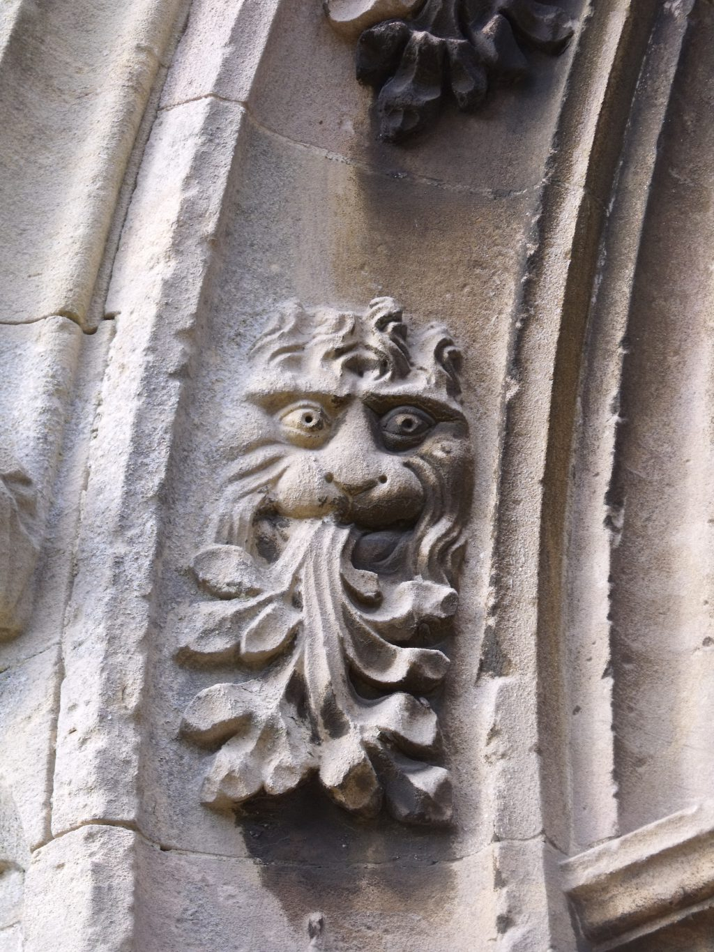 Eeek! You'll find this stone 'grotesque' face on the arch round the door at Woolpit
